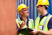 Harbor worker talking at container depot — Stock Photo