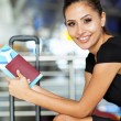 Businesswoman waiting for flight — Stock Photo #27331329