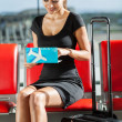 Businesswoman checking her flight ticket — Stock Photo