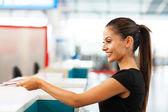 Businesswoman handing over air ticket — Stock Photo