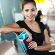 Young woman waiting for flight at airport — Stockfoto