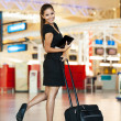 Young businesswoman going on a business trip — Stock Photo