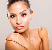 Beautiful young model face closeup on plain background — Stock Photo