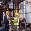 Petrochemical manager in discussion with plant worker — Stock Photo
