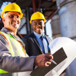 Senior oil industry worker and manager — Stock Photo