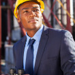 Afro american petrochemical businessman with binoculars — Stock Photo