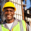 Africworker in petrochemical plant — Photo #27583583