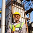 Afro american oil industrial worker in refinery plant — Stock Photo