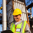 Middle aged heavy industry worker in plant — Stock Photo