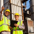 Fuel chemical workers at refinery plant — Stock Photo #27584497