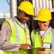 Heavy industry workers working in plant — Stock Photo