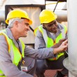 Petrochemical technicians inspecting fuel tank — Stock Photo