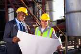 Industrial engineers with blueprint — Stock Photo