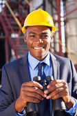 African american petrochemical manager with binoculars — Stock Photo