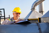Middle aged oil chemical industry technician — Stock Photo