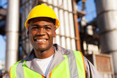 African worker in petrochemical plant — Foto Stock