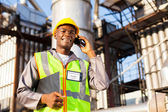 African oil chemical worker talking on cell phone — Foto Stock