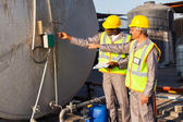 Industrial engineers inspecting fuel tank — Stock Photo