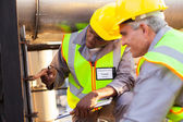 Mechanical engineers working on fuel pipeline — Stock Photo