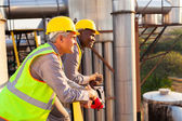 Industrial workers in safety gear — Stock Photo