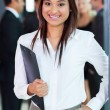 Young indian office worker holding a clipboard — Stock Photo #27891013