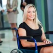 Disabled businesswoman sitting in a wheelchair — Stock Photo
