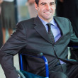 Optimistic handicapped business executive — Stock Photo #27894085