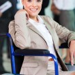Stock Photo: Handicapped young woman in modern business world