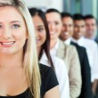 Group of business people in a row — Stock Photo #27897675