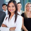 Stock Photo: Young indian businesswoman and team