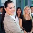 Businesswoman in office with co-workers — Stock Photo