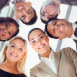 Stock Photo: Group of business people looking down