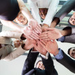 Underneath view of business people hands together — Stock Photo