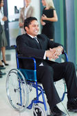 Indian businessman in wheelchair — Stock Photo