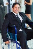 Optimistic handicapped businessman — Stock Photo