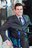 Optimistic handicapped business executive — Stock Photo