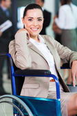 Handicapped young woman in modern business world — Stock Photo