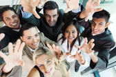 Cheerful group of business people reach out — Stock Photo