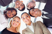Group of business people looking down — Stock Photo