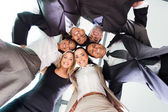 Underneath view of business people — Stockfoto