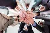 Underneath view of business people hands together — Stok fotoğraf