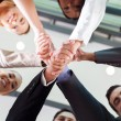 Underneath view of businesspeople handshaking — Foto de stock #27900041
