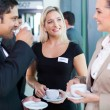 Business people having coffee break during seminar — Stock Photo #27900641