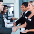 Stock Photo: Business people handshaking