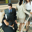 Group of office workers walking on stairs — Stock Photo
