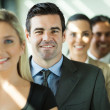 Stock Photo: Group of business people in row