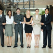 Group of business people holding hands — Stock Photo