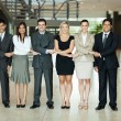 Group of business people holding hands — Stockfoto
