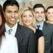 Business executives standing in a queue — Stock Photo #27903663