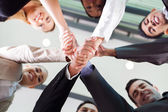 Underneath view of businesspeople handshaking — Stok fotoğraf
